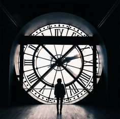 """""""The key to getting a crowdless shot is to arrive early and begin backwards. The massive clock that overlooks the Louvre is located near the gift shop. Head up to the fifth floor before visiting the museum's main attractions."""""""