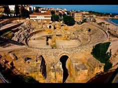 Places to see in ( Tarragona - Spain )  Tarragona is a port city in northeastern Spains Catalonia region. Many ancient ruins remain from its time as the Roman colony of Tarraco. The Amfiteatre Romà is a 2nd-century arena facing the Mediterranean the Passeig Arqueològic has sweeping views of the city.  Tarragona is a port city located in northeast Spain on the Costa Daurada by the Mediterranean Sea. Tarragona is the capital of the Province of Tarragona  The Roman ruins of Tarraco have been…