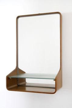 Friso Kramer; Bent Plywood, Glass and Brass 'Euroika' Wall Mirror for Auping, 1963.