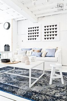 A Great rug anchors the room; indigo overwashed, TUTZI store Netherlands