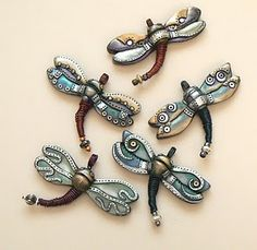 Polymer clay dragonflies steampunk style.  I'd never be able to make these, but I LOVE them!