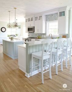 When you pair Ella™ marble quartz countertops, driftwood cabinetry, and aqua tones, the result is the perfectly balanced coastal kitchen by @JKathD…