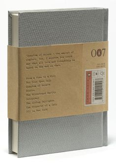 Hyland created a cloth-covered hardback with cover imagery restricted to a silver foil-blocked image of Bond's infamous Walther PPK (shown here with silencer). A subtle diamond pattern is debossed on to the boards, which combined with deep burgundy endpapers evokes the discerning elegance of Bond's world. An embossed manila bellyband with typewritten cover information on the label evokes the official documents of the period.