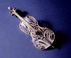 "Brooch | Victoria Lansford.  ""Cello"".  Russian filigree; 18 and 22k gold, fine silver."