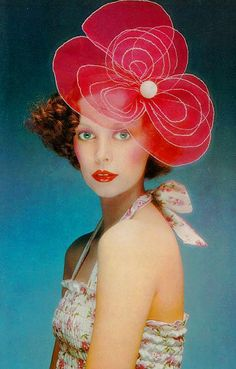 Model Mouche in a red floral headpiece and summer ruched halter blouse by Pablo and Delia. UK Vogue May 1972.