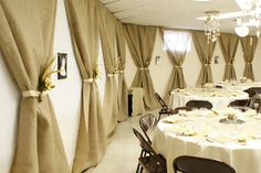 This is kinda neat for reception or at the front at the ceremony... Burlap panels with ribbon for walls @Tara Harmon Lindblom