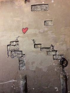 Chasing love. Santo Spirito, Firenze. Street art.