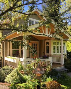 The lush gardens are key to this kind of small house density // Pocket Neighborhood, Lush Garden, Pergola, Gardens, Outdoor Structures, Cabin, Key, House Styles, Instagram Posts