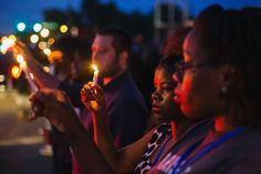 Michael Brown shooting: a timeline.  candlelight vigil