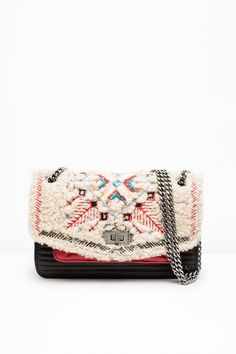 "Zadig & Voltaire small quilted bag, chain strap, can be worn cross body or on the shoulder, ZV rivet and military clasp, engraved eyelets, 5.5x15x18cm/2.1x5.9x7"", hair-on leather and lambskin leather. This model is the versatile Zadig & Voltaire bag, redesigned every season. It wears perfectly for casual outfits as for the most dressy outfits."