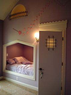 "Cute! Bed nook, door leads to the closet, which holds a ladder to the attic's reading space, with the ""balcony"" window above the bed to look out!"