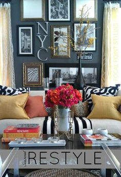 Adding a simple punch of color can really wake up a home for Spring! Just layer in pillows from HomeGoods with faux flowers + colorful coffee table book stacks to be #HomeGoodsHappy - Lynda Quintero-Davids - #HappyByDesign