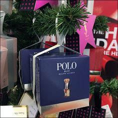 Polo Ralph Lauren and Yves Saint Lauren are the most prominent heroes on this Famous Brand-Name Christmas-Tree Ornaments display. Christmas Balls, Retail Fixtures, Famous Brands, Visual Merchandising, Polo Ralph, Brand Names, Ralph Lauren, Christmas Baubles