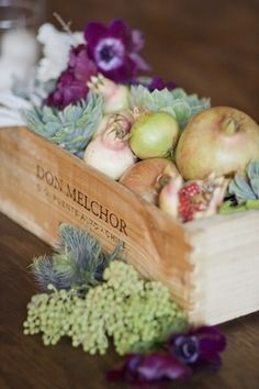 Fruit & flower centerpieces in a wine box.