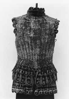 Italian brigandine armour, consists of steel plates riveted together and covered with leather or fabric.