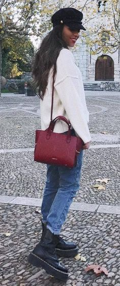 awesome outfit / hat + white oversized sweater + red bag + jeans + boots