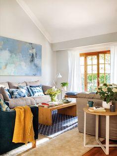 salon en tonos azules decorado por Kenay cuadro grande