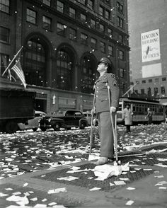 Staff Sgt. Arthur Moore of Buffalo N.Y. who was wounded in Belgium stands on 42nd Street near Grand Central Station in New York on May 7 1945 as New Yorkers celebrate news of VE Day [1280 x 1599] http://ift.tt/2fG2YWg