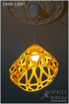 ZAHA LIGHT Futuristic ceiling pendant light with bionic form and mandala design made by lasercut  from synthetic felt fabric inspired by architectiral projects of Zaha Hadid. This light can be used as  public spaces, as well as private apartments. Colour versions can be used for childroom or for teenagers rooms.