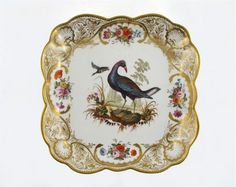 An important Nantgarw square dish from the MacIntosh service, painted with a wading bird standing on mossy rocks between aquatic plants, before a duck in flight, within borders of floral sprays & gilt shell & foliate motifs, c.1818-20, 24.2cm.  Cf. W D John, Nantgarw. The painting on plates & dishes from this service is now believed to have been executed by Thomas Martin Randall at the establishment of Messrs. Robins & Randall, after engravings from Le Vaillant of Paris (c.1801-06).