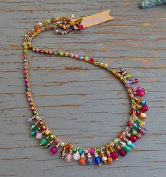 This necklace is full of bright sparkling colour!its crocheted with sparkly specialty crystals and gemstones and specialty beads, wire wrapped drops are added that sway a little. you cant help but notice it its fun, and colourful - approx 19 inche Boho Jewelry, Jewelry Crafts, Beaded Jewelry, Jewelery, Jewelry Necklaces, Handmade Jewelry, Jewelry Design, Beaded Bracelets, Necklace Ideas