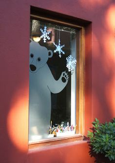 Holiday window idea by GennineThis polar bear was part of our homeschool Christmas decorations. It was created with cutout sandblasted 3M plastic self adhesive film, that I drew directly on the window.