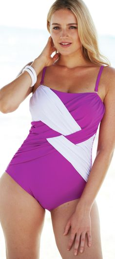 PLUS SIZE - click thru to article. Find link to magenta color-block swimsuit in comments at bottom of page - http://www.boomerinas.com/2014/03/21/swimsuit-shapes-for-apple-bodies-13-tips-for-big-tummies/