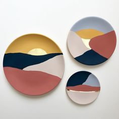 Our set of three hand painted ceramic wall plates are a unique way to add art to your walls.  Painted with a matt chalky finish and hints of gold leaf, they are inspired by desert landscapes and the rising and setting sun.