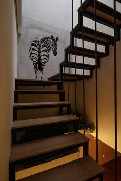 La escalera que conecta los dormitorios