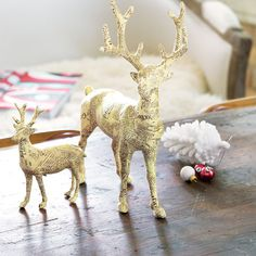 Inspired by the peaceful quiet of a snowy forest, our stunning duo of Papier Mâché reindeer exudes artful holiday elegance. Covered in strips of vintage style newsprint on a sturdy mâché form and embellished with gilded gold glitter, this pair of papier mâché reindeer have a beautifully intricate hand crafted look. Measuring approximately 6 and 13 tall, the pair comes gift wrapped together in a hand crafted wood crate with ribbon.