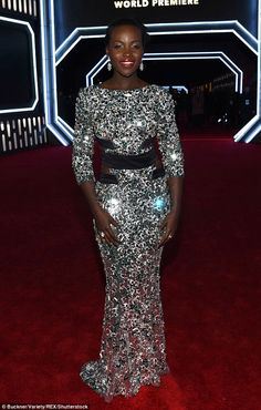 Shining star: LupitaNyong'o looked exquisite in a shimmering floor length number at the premiere of Star Wars: The Force Awakens on Monday