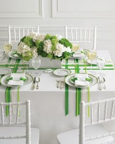 Create your own custom linens with colored ribbons on a simple white table cloth.