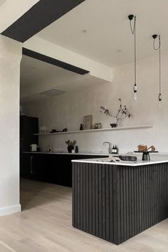 Are you looking to change the decoration of your old kitchen? Why replace when you can upgrade? You can give your walls and furniture a new look by covering them with Cover Styl' adhesive films. Kitchen cupboard, drawer, splashback, worktop, table, bar... Everything is possible! Save time and money, this is the solution to get a kitchen on a budget. Here is Loft208's kitchen makeover. The cabinets were wrapped with a black wood effect vinyl. Get more ideas to change your kitchen design!