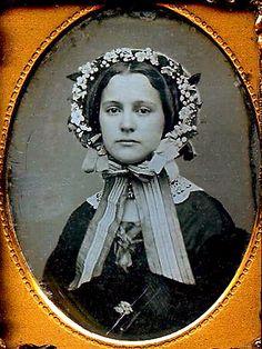 Woman in flowered bonnet