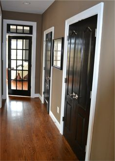 Black doors, white edge, wood floors with that nice tan on the walls. - up and down hallways & front living room, and dining room. Color on walls (mocha from Sherwin Williams SW + white trim and black doors. Home Diy, Home Remodeling, Interior, Black Interior Doors, House, Home Projects, Home Decor, Black Doors, Home Deco