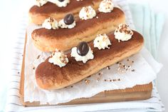 Tiramisu eclairs (Laura's Bakery) Eclairs, Tiramisu, Tortilla Chips, Hot Dog Buns, A Food, Creme, Cheesecake, Cupcakes, Breakfast