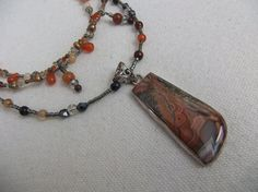 Crazy Lace Agate Sterling Silver Pendant on by centerofbalance, $135.00