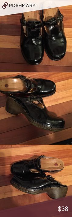 Black patent leather Clarks clogs Black patent leather Clarks clogs. Very soft insoles and very comfortable all around. In very good condition. Clarks Shoes Mules & Clogs