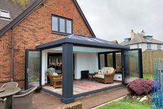 This beautiful contemporary orangery features an Ultrasky Roof and flat cornice with stunning bi-fold doors around two sides. Orangery Extension Kitchen, Glass Roof Extension, Conservatory Extension, House Extension Plans, House Extension Design, Kitchen Orangery, Extension Designs, Extension Ideas, Conservatory Prices