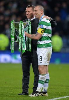 Celtic manager Brendan Rodgers celebrates with Celtic captain Scott Brown as Celtic win the Betfred Cup Final between Aberdeen FC and Celtic FC at Hampden Park on November 27, 2016 in Glasgow, Scotland.