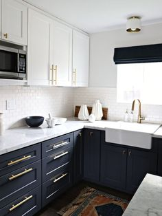 The navy cabinets and dark floor against the upper white in the kitchen create i. The navy cabinets and dark floor against the upper white in the kitchen create implied light and brightness Home Decor Kitchen, Interior Design Kitchen, Diy Kitchen, Home Design, Design Ideas, Kitchen Paint, Kitchen Designs, Kitchen Themes, Kitchen Modern