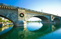 """London Bridge, Lake Havasu City, Arizona     """"London Bridge was falling down, so it got relocated to Lake Havasu City, Ariz. No, really. It is the very London Bridge built in 1831. But by the mid-20th century, it could no longer handle the load of London's traffic and got auctioned off to an Arizona oil baron — he spent 2,460,000 on the bridge and then an extra 7 million to have it dismantled and reconstructed in Lake Havasu City in 1971."""""""