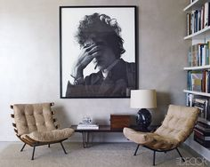 A striking photograph of Bob Dylan by Jerry Schatzberg creates a focal point in the living area of Andrew Rosen and Jenny Dyer's Manhattan Apartment. Tour the rest of the home.