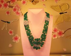 Necklace using unfaceted emerald and diamond beads with diamond set platinum decorations; Van Cleef & Arpels