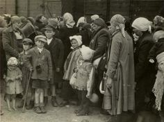 Auschwitz Birkenau, Poland, A group of women and children prior to being taken to the gas chamber. They have a few hours of life left