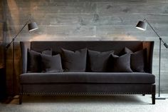 Tuxedo sofa flanked by two sculptural lightring fixtures. DONE!