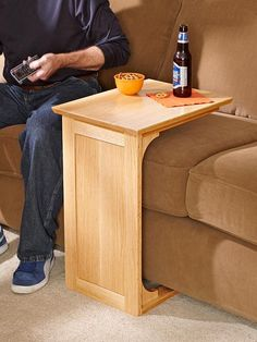 Easy Woodworking Projects Sofa Server Woodworking Plan from WOOD Magazine - Keep beverages, snacks, and the remote nearby on this easy-to-build server while you take in the big game or your favorite show. Featured in WOOD Issue May 2013 Easy Woodworking Projects, Popular Woodworking, Woodworking Furniture, Fine Woodworking, Diy Wood Projects, Diy Furniture, Woodworking Workshop, Woodworking Techniques, Woodworking Articles