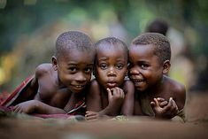 Timothy Allen | Smiling Bayaka children playing on the ground