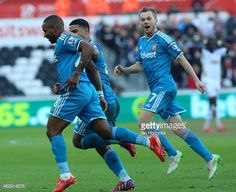 Sunderland players celebrate with Jermain Defoe (L) after he scored the opening goal during the Barclays Premier League match between Swansea City and Sunderland at the Liberty Stadium on February 07, 2015 in Swansea, Wales.