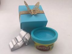 Mini play doh kits with a glass slipper or butterfly shaped cutter in a Cinderella themed decorative box with ribbon and butterfly
